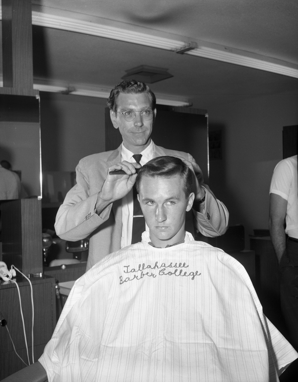 Hair being cut and styled at the Tallahassee Barber College.
