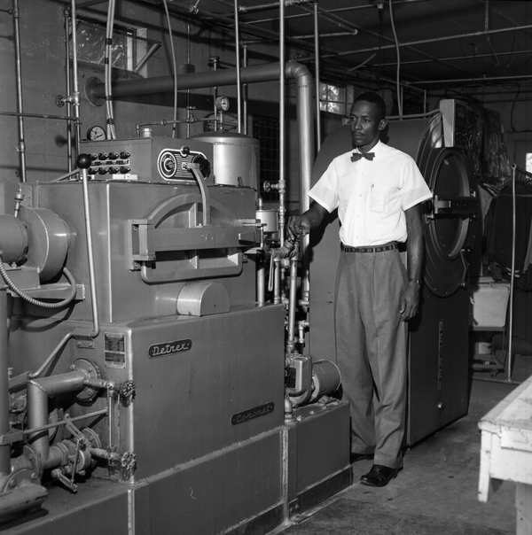 Harold Knowles operating machine at Knowles Cleaners and Coin Laundry in Tallahassee.