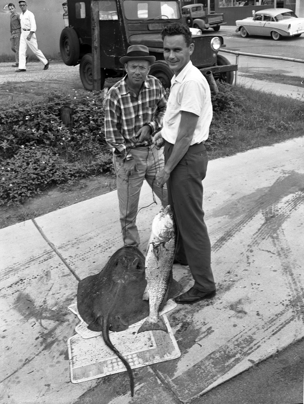 Men in Tallahassee with stingray and fish.