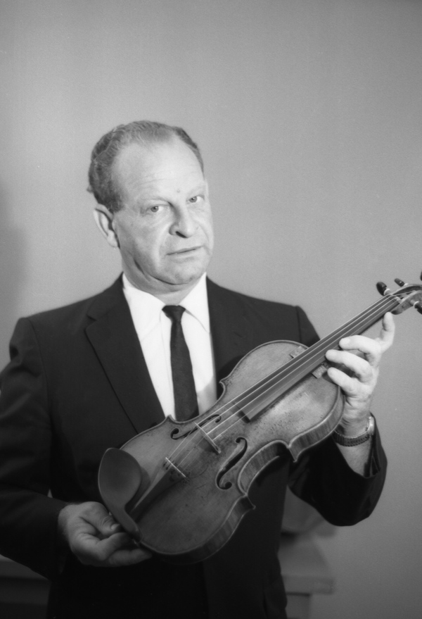 Portrait of Ralph Rosenberg with a violin in Tallahassee.