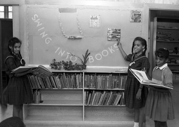 African American girls in their school's library in Tallahassee during National Book Week.