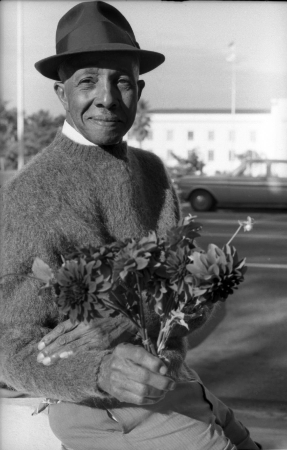 Close-up view of African American man selling flowers in Tallahassee.