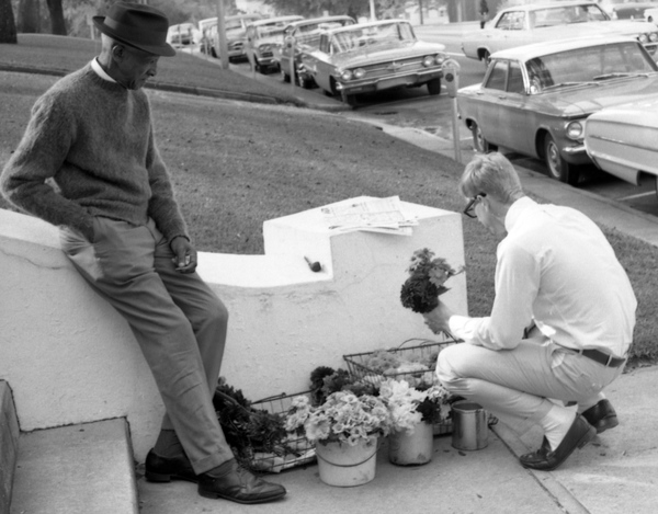 Man buying flowers from a street vendor in Tallahassee.