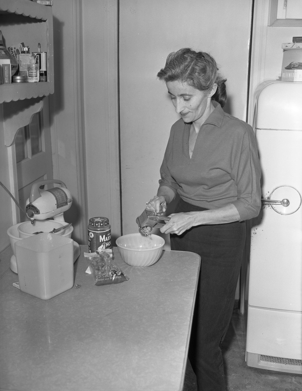 Denise Mamatey grinding walnuts in Tallahassee.