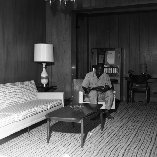 Man sitting in the lobby of The A&M Hotel in Tallahassee.