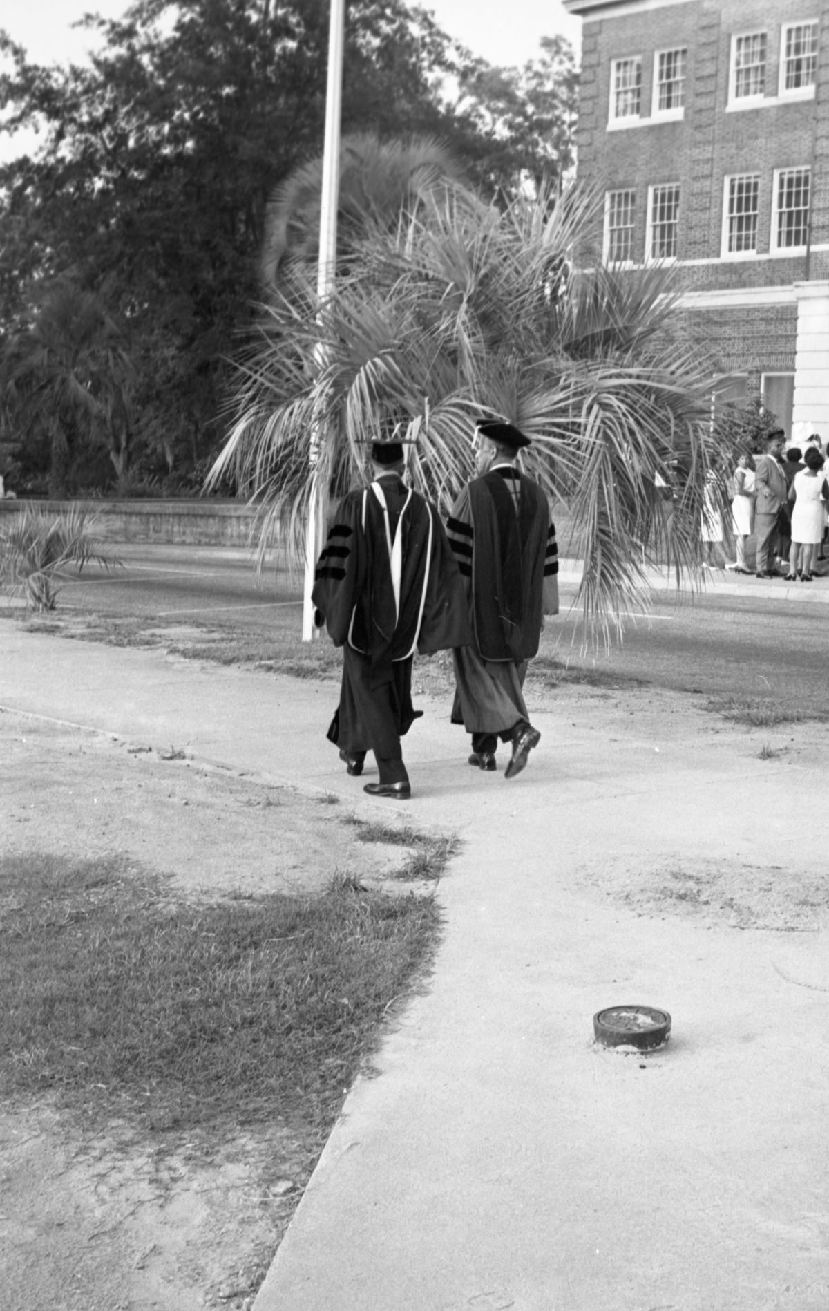 FAMU president Dr. Gore, left, walking with Morehouse College president Dr. Gloster after the commencement exercises in Tallahassee.
