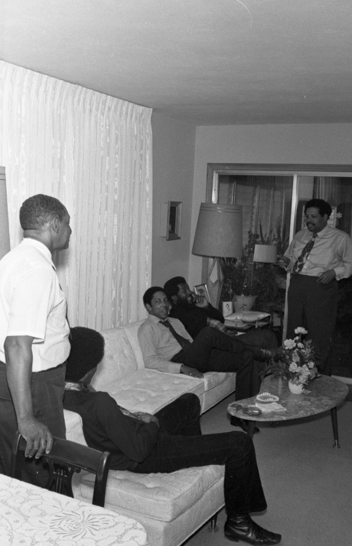 Cannonball Adderley, right, and his band at home with his father J.C., left, in Tallahassee.