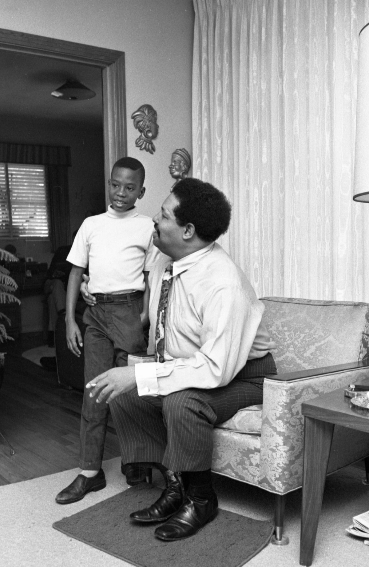 Unidentified boy with Cannonball Adderley at his father's home in Tallahassee.