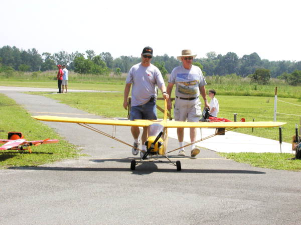 Piper cub being brought back after flight..