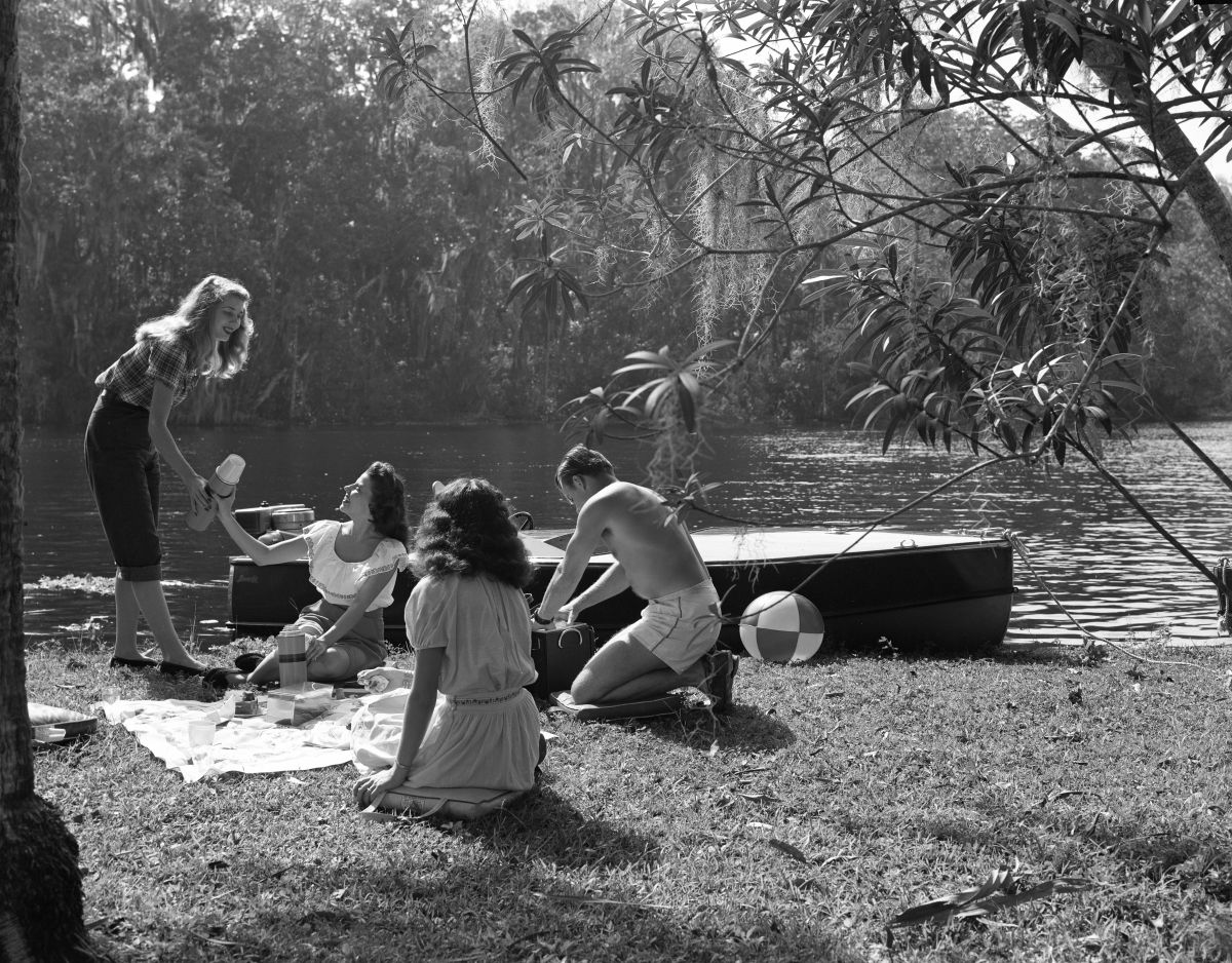 Visitors having a picnic beside the river - Homosassa Springs, Florida.