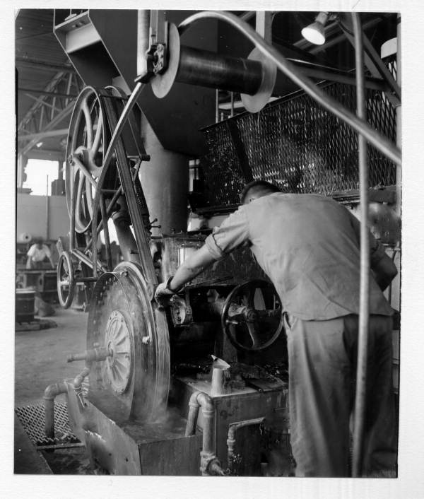 Chuck Hackwalt working with casting machine at the General Cable Corp. in Tampa, Florida.