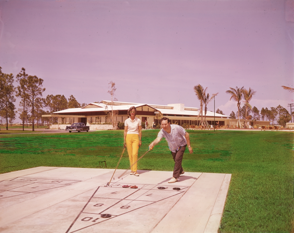 Couple playing shuffleboard at the Port St. Lucie Country Club.