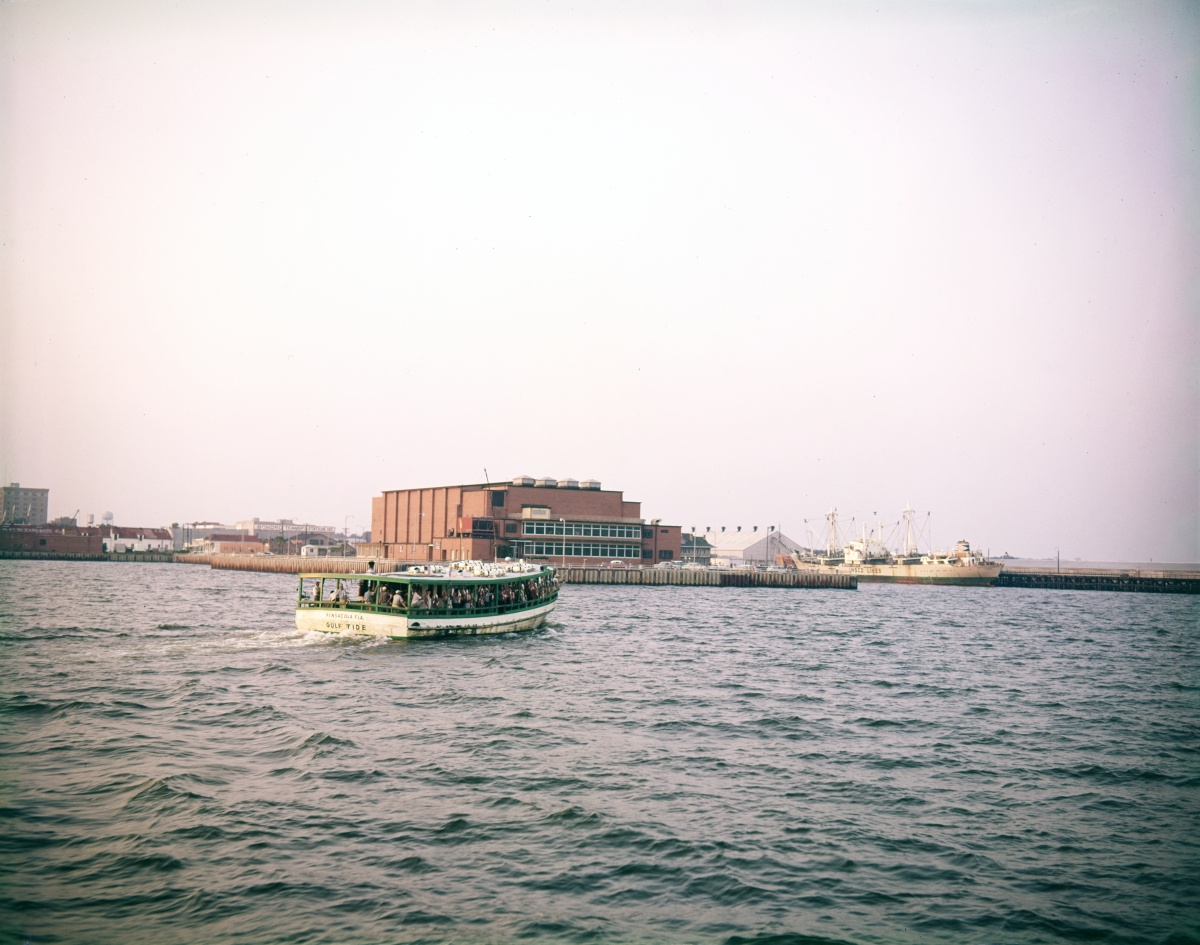 """Party fishing boat """"Gulf Tide"""" passing the Municipal Auditorium in Pensacola."""