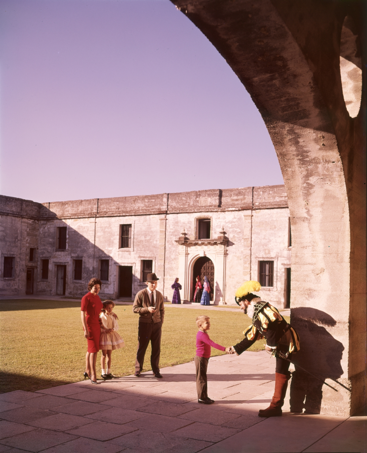 Visitors in the courtyard with costumed reenactor at Castillo de San Marcos in St. Augustine.