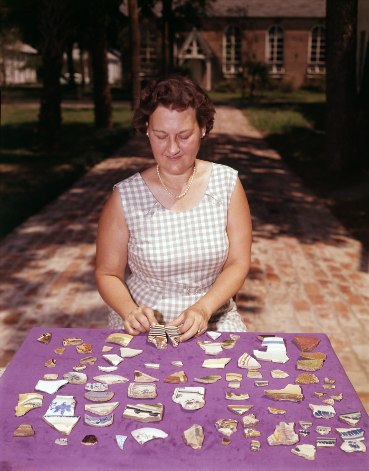 Leora M. Sutton with pottery pieces excavated from lots 8 and 9 on Zaragoza Street in Pensacola.