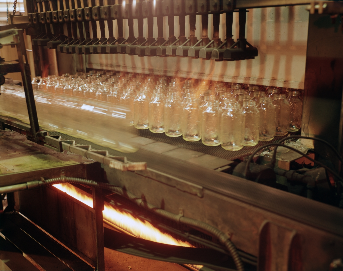Close-up view showing bottles being made at the Thatcher Glass Manufacturing Company in Tampa.