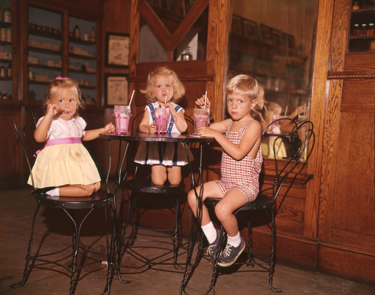 Children having milkshakes at Quina's Apothecary in Pensacola.