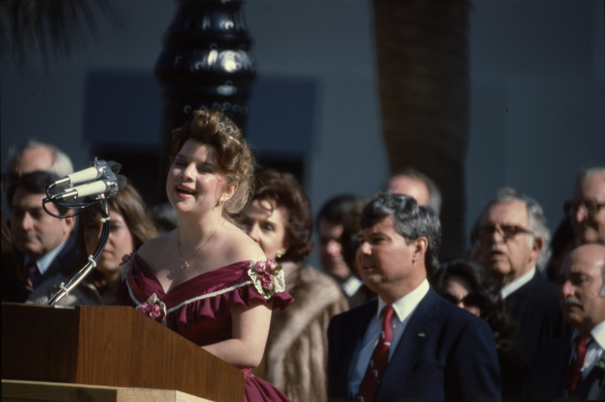Unidentified woman at the microphone during inauguration of Governor Graham in Tallahassee.