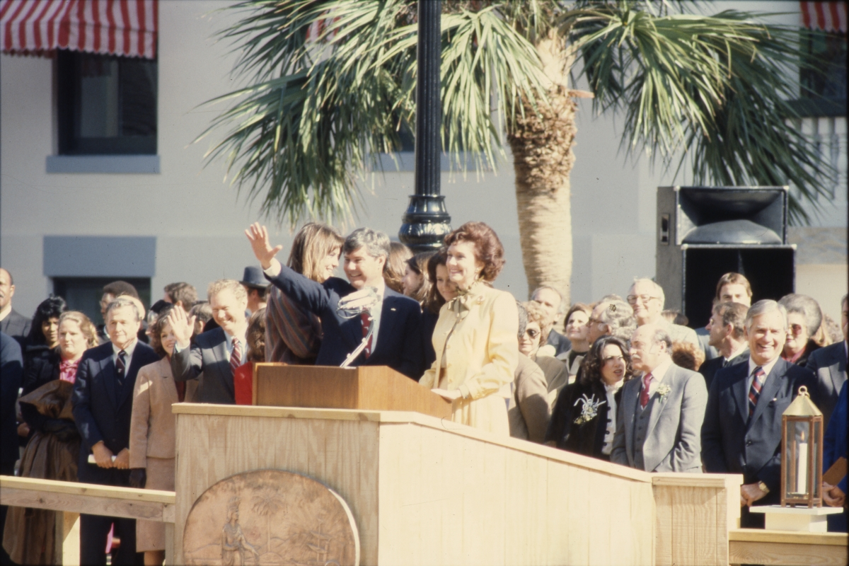 Governor Graham with his wife waving to the crowd during his inauguration in Tallahassee.