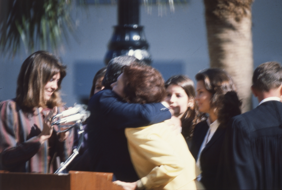 Governor Graham hugging his wife during his inauguration in Tallahassee.
