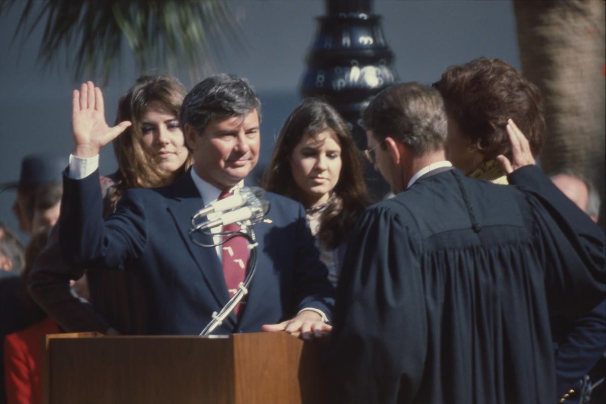 Governor Graham taking oath of office from Chief Justice James Alderman in Tallahassee.
