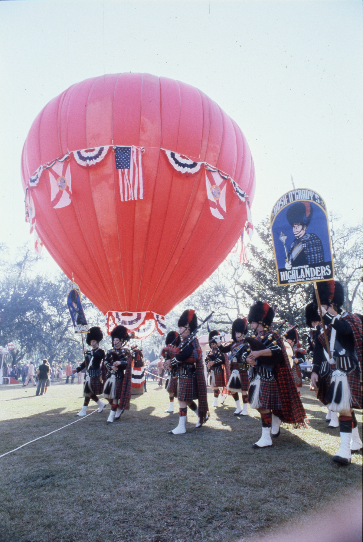 Rosie O'Grady's Scottish Highlanders marching by hot air balloon during Governor Graham's inauguration party.