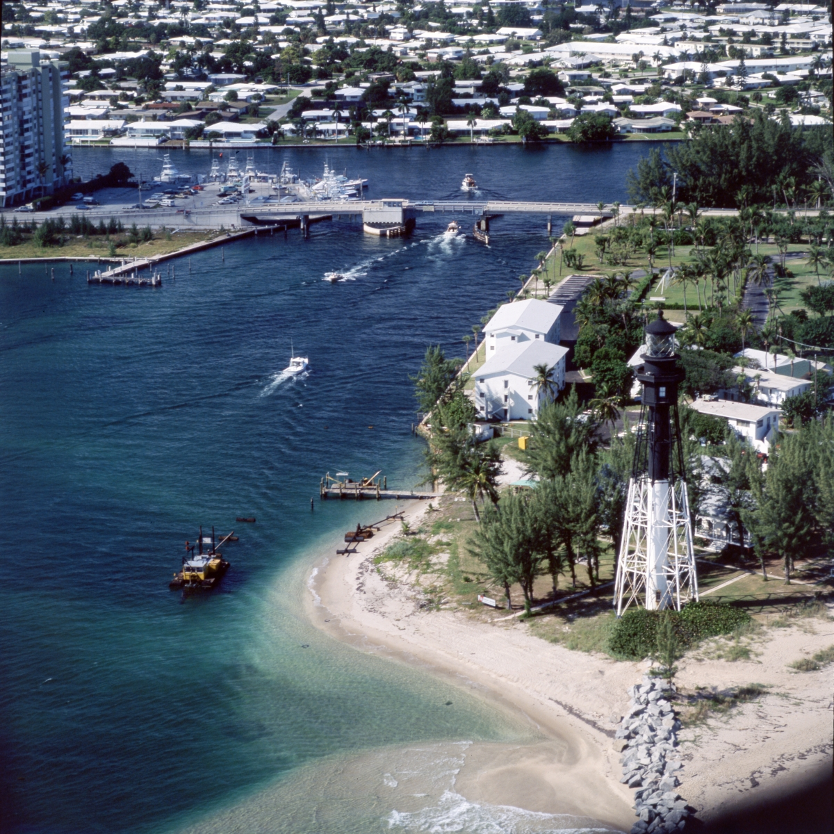 Aerial view looking northwest at the Hillsboro Inlet with lighthouse.