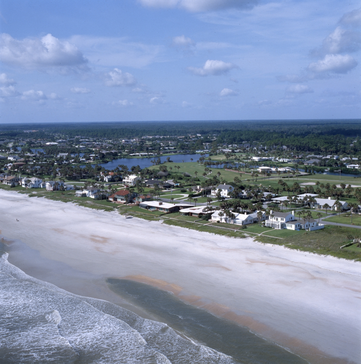 Aerial view looking southwest at houses next to the Ponte Vedra Inn & Club golf course.