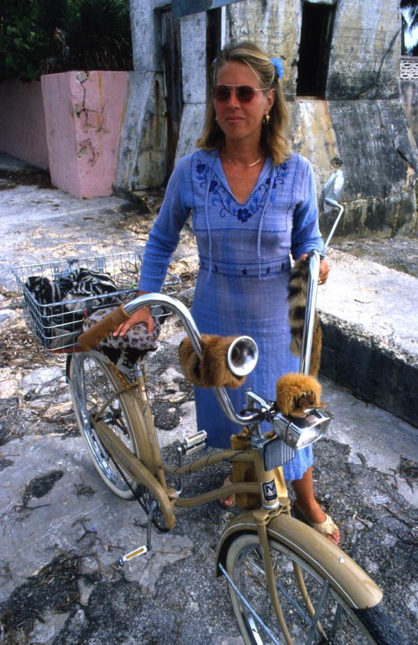 Portrait of a woman with her bike at the Southernmost Point in U.S.A. at Key West.