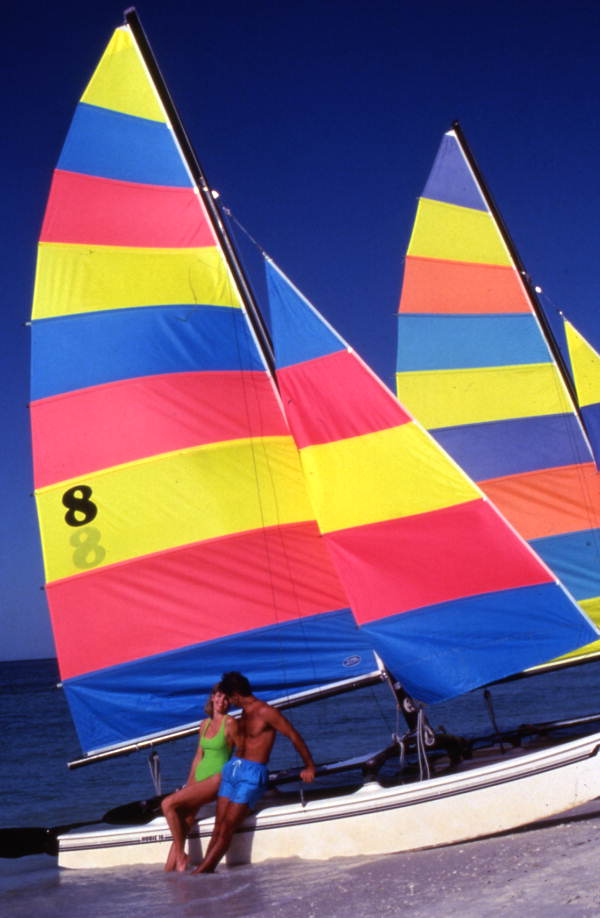 Couple with a Hobie catamaran at the beach on Marco Island.