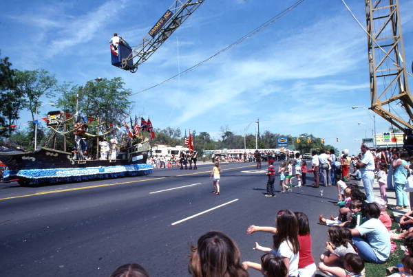 Crowd watching the Fiesta of Five Flags float in the Springtime Tallahassee parade on Monroe St.