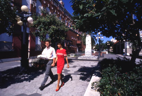 Couple walking in the Latin Plaza at Ybor City.