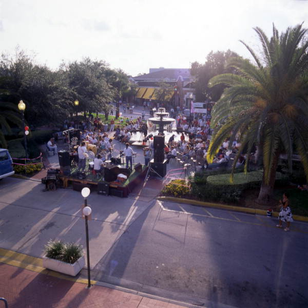 View showing a band performing a concert in the historic Hyde Park district of Tampa, Florida.