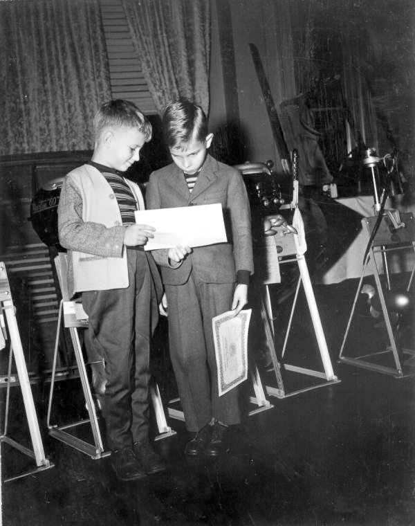 8 year olds Wallace McMullen and John Herbert examine their junior membership certificates to the Florida Tackle & Gun Club - Jacksonville, Florida.