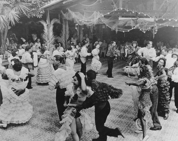 Conga line dancing at a carnival in Key West.