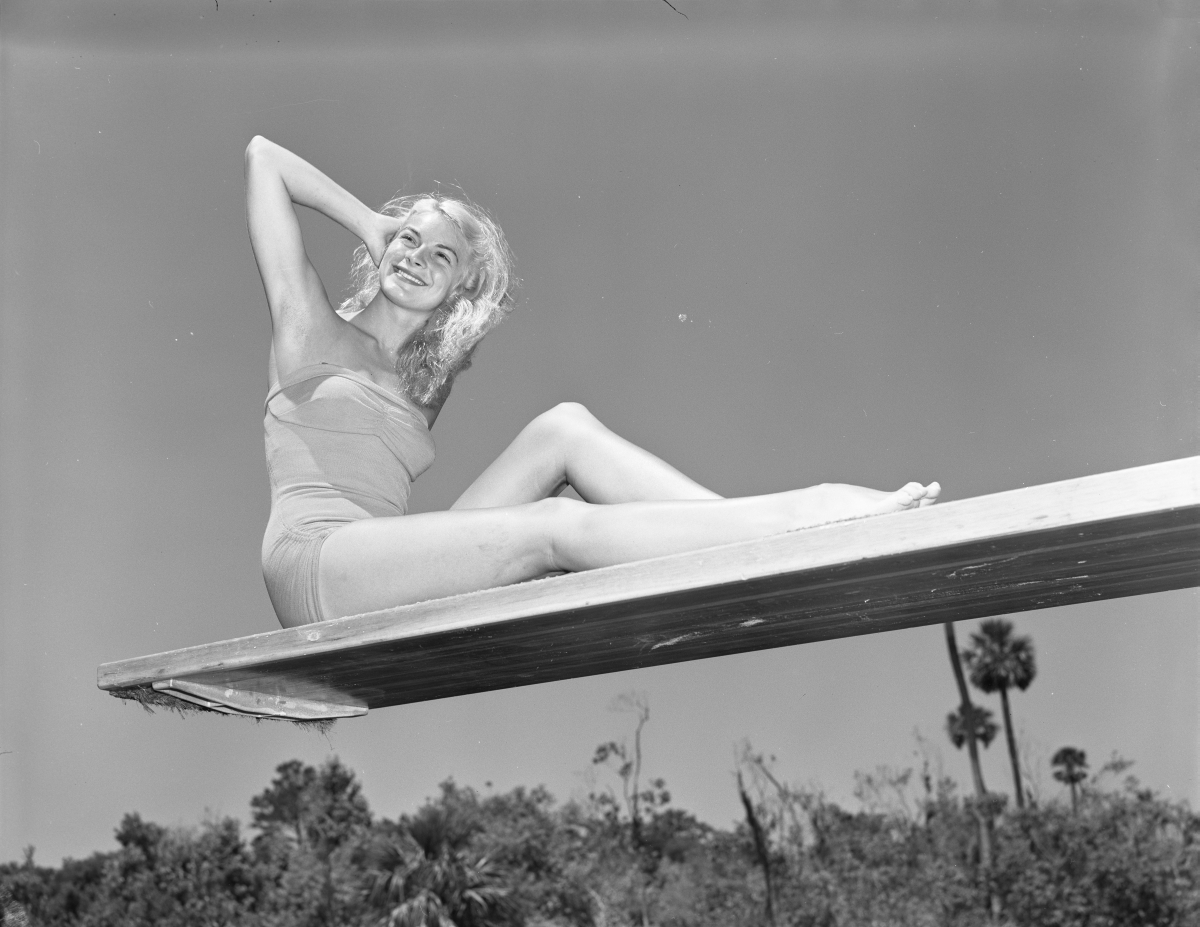 Portrait of Ginger Stanley sitting on a diving board - Weeki Wachee Springs, Florida.