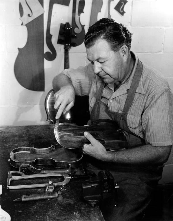 Violin maker Dudley Reed restoring a violin.