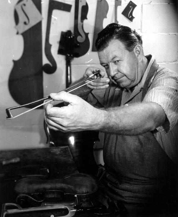 Violin maker Dudley Reed checking a violin bow.