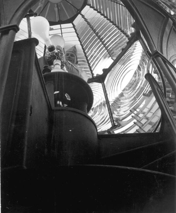 Interior view showing lighthouse keeper with bulbs inside the Pensacola Lighthouse - Escambia County, Florida.