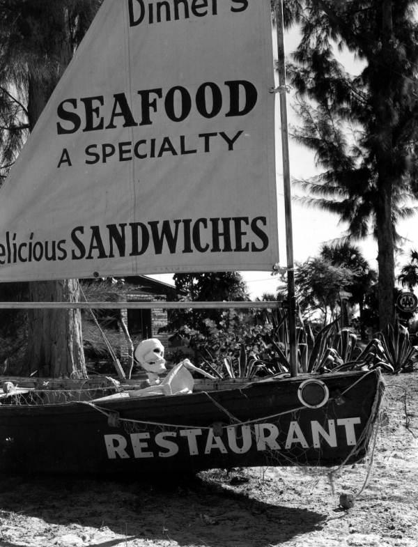 Seafood restaurant's advertisement at Sanibel-Captiva Islands - Lee County, Florida.