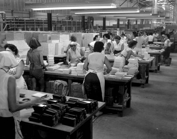 Female employees working at packing line in the Tiffany Tile plant - Tampa, Florida.