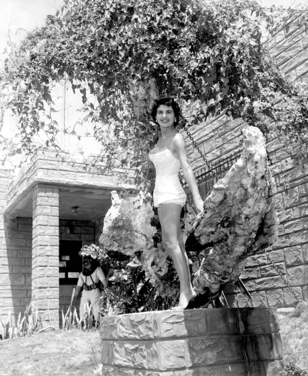 Jackie Sweeting poses with anchor on display at McKee's Museum of Sunken Treasure - Plantation Key, Florida