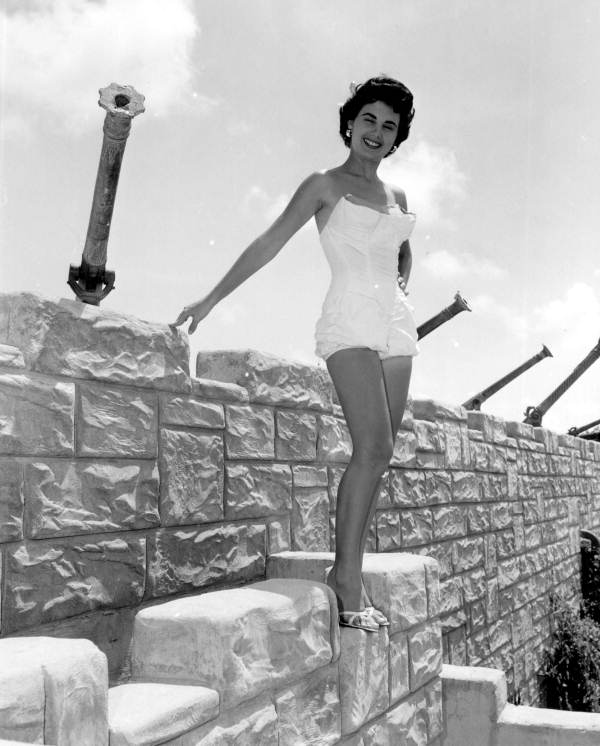 Jackie Sweeting poses on the wall of the McKee's Museum of Sunken Treasure - Plantation Key, Florida