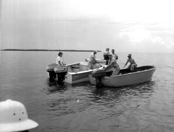 Fishing conservation agents check the legal sizes of a fishing party's catches - Everglades, Florida.
