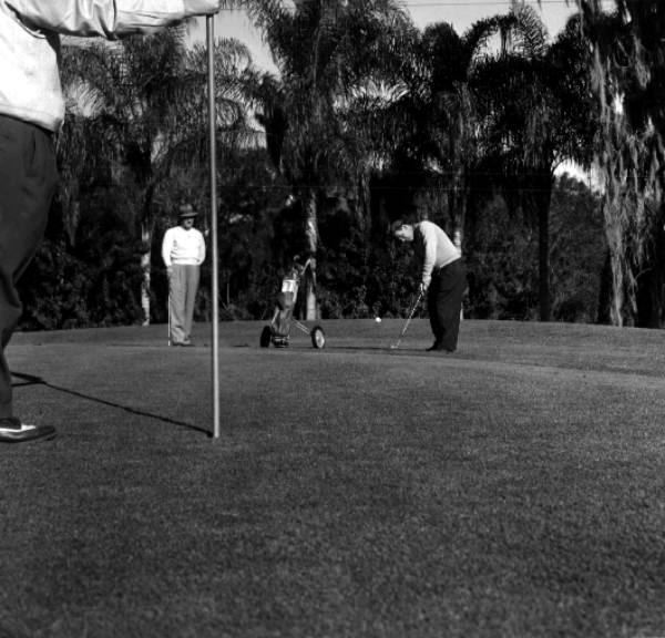Golfers play in front of one of the golf facilities - Tampa, Florida .