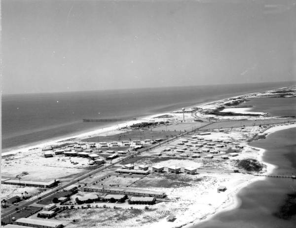 Aerial view of dwellings on the beach.
