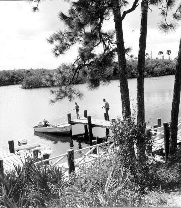 Jonathan Dickinson State Park visitors fishing from dock at Hobe Sound - Martin County, Florida.