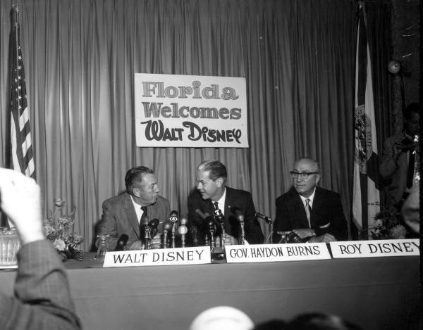 Walt Disney with company at press conference - Orlando, Florida.