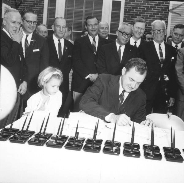 Governor Claude Kirk signing the Disney bill at the Governor's mansion - Tallahassee, Florida.