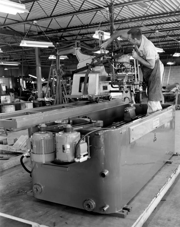 Dishwashing machines receive a final check before shipping - Tampa, Florida.